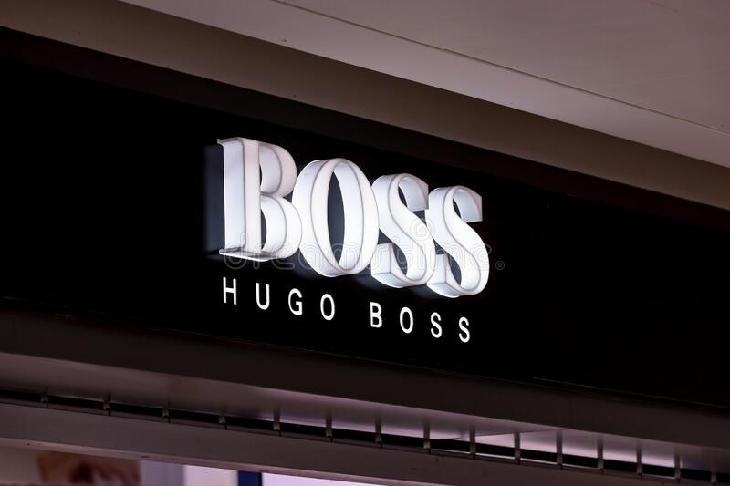 A logo of Hugo Boss  brand of a side of of store in the mall of New York Airport royalty free stock photography