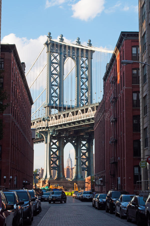 New York, Usa: an iconic view of Manhattan Bridge from Dumbo neighborhood on September 16, 2014. The Manhattan Bridge, known as the famous landmark, opened to stock photos