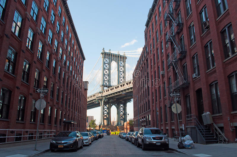 New York, Usa: an iconic view of Manhattan Bridge from Dumbo neighborhood on September 16, 2014. The Manhattan Bridge, known as the famous landmark, opened to stock photo