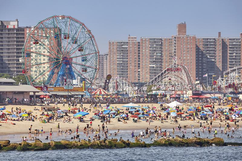 Crowded Coney Island beach and amusement park on a warm, hazy day. New York, USA - July 02, 2018: Crowded Coney Island beach and amusement park on a warm, hazy royalty free stock images