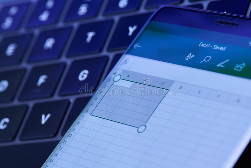 Microsoft excel menu on smartphone screen. New york, USA - July 6, 2018: Microsoft excel menu on smartphone screen lay on laptop keyboard stock photography