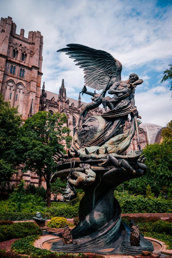NEW YORK, USA - JULY 13, 2016: statue near St.John cathedral the stock photos