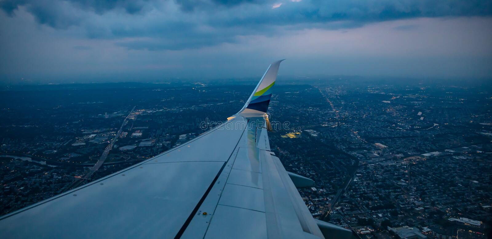 Alaska airlines plane flying over Newark in the evening, USA stock image