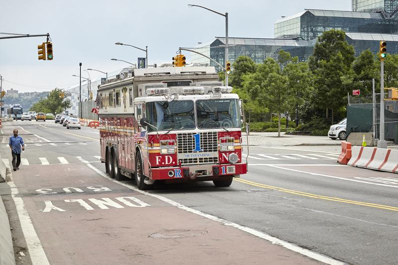 New York City Fire Department rescue truck on a street of Manhattan. New York, USA - 28 June 2018: New York City Fire Department rescue truck on a street of royalty free stock photos