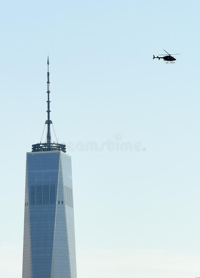New York, USA - June 9, 2018: One World Trade Center and helicopter in the sky of New York. stock photo