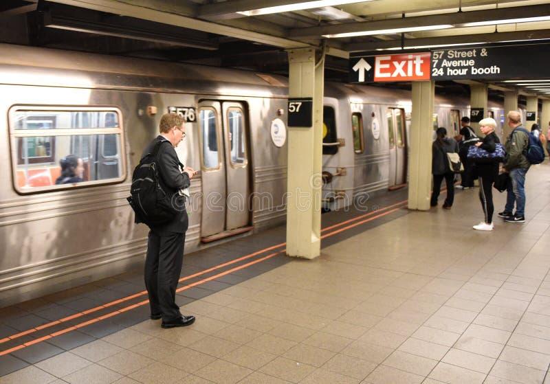 New York, USA - June 8, 2018: People on subway platform waiting stock image