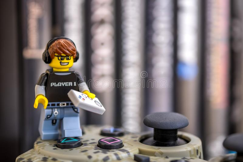 Lego Video Game Guy on a controller royalty free stock image