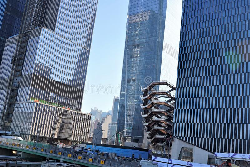 New York, New York / USA - March 09 2019: Vessel, Hudson Yards under construction, with workers stock images