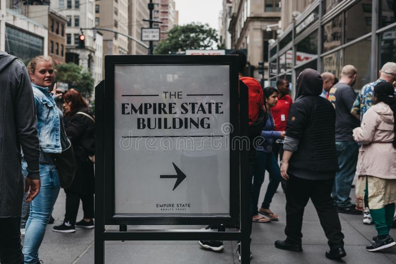 Direction sign at the entrance to Empire State Building, Midtown royalty free stock photos