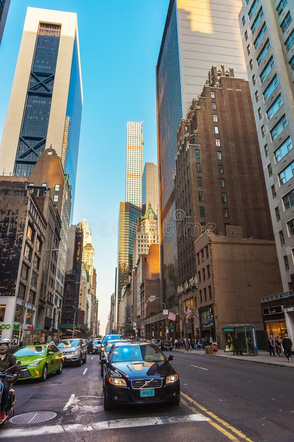 Sixth Avenue and West 57th Street in Midtown Manhattan NYC. New York, USA - May 6, 2015: Intersection of Avenue of the Americas, or Sixth Avenue, and West 57th royalty free stock photo