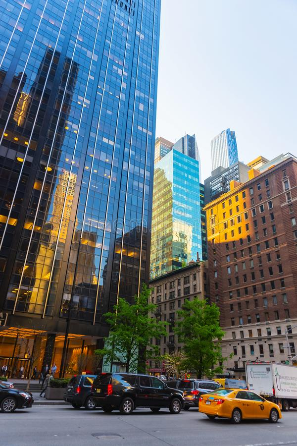 Sixth Avenue and West 55th Street in Midtown Manhattan NYC. New York, USA - May 6, 2015: Intersection of Avenue of the Americas, or Sixth Avenue, and West 55th stock image