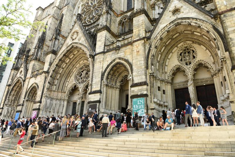 New York, USA - May 25, 2018: People near The Cathedral Church o. F St. John the Divine in New York royalty free stock photo