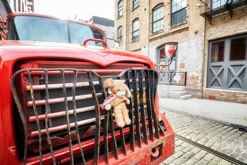 Plush mascot fastened to a truck bumper parked on a street in Brooklyn Dumbo. New York, USA - May 24, 2017: Plush masqote fastened to a truck bumper parked on a royalty free stock photography