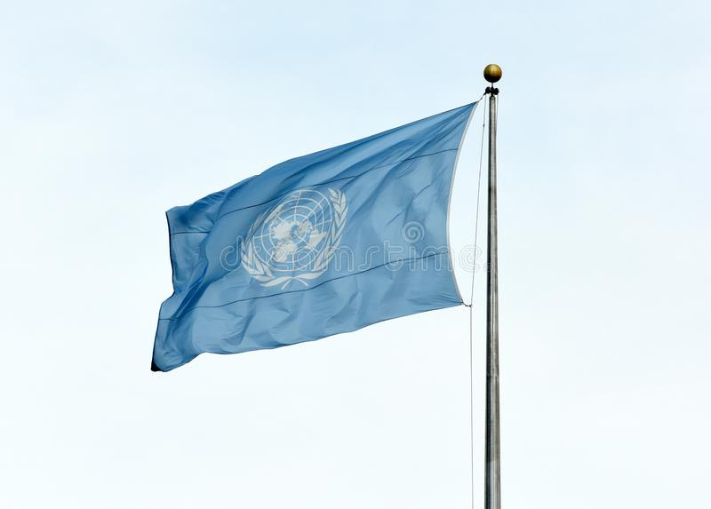 NEW YORK, USA - May 26, 2018: UN flag waving in the sky near the royalty free stock photos