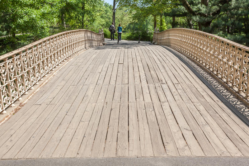 New York, USA- May 21, 2014. Young couple walking over the bridge in Central park in New York City. royalty free stock photos