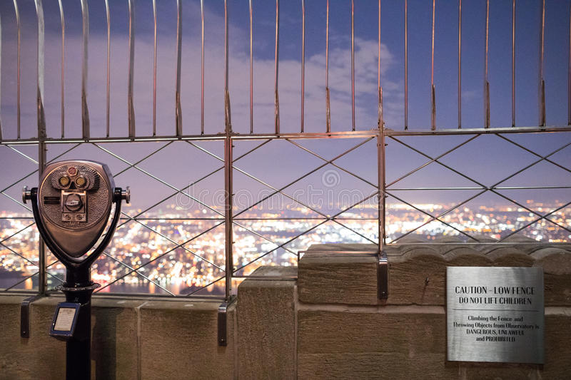 Binoculars on top of Empire State Building at Night in Manhattan stock photography