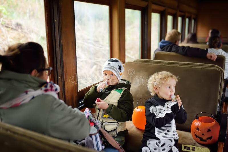 New York, USA - October 27, 2018: People ride in traditional train express on celebrations halloween near New York royalty free stock images