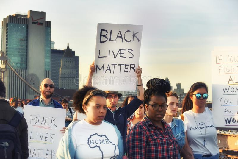 New York, USA, October 01, 2018. Procession in support of people of different colors on the Brooklyn Bridge stock photography