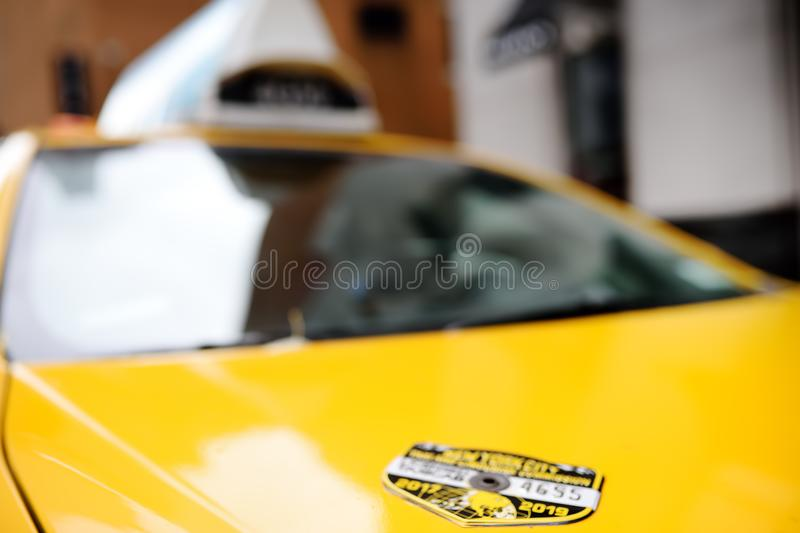 NEW YORK, USA - OCTOBER 29, 2018: Typical American yellow badge taxi stock photos
