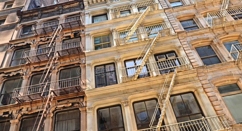 New York USA, old colorful classic buildings, facade, architecture, balcony and windows in Soho, Downtown Manhattan royalty free stock images