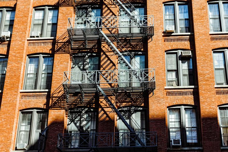 Escape fire ladders in Dumbo, Brooklyn. NEW YORK, USA - Sep 22, 2017: Escape fire ladders at house facades in Dumbo, Brooklyn stock images