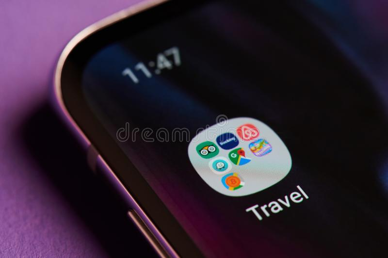 Folder with apps for travel in smartphone stock photography