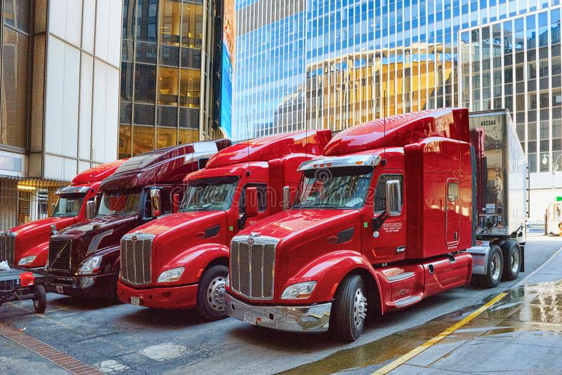 Large American truck trucker in New York. Midtown district. USA. New York, USA- September 09, 2017 : Large American truck trucker and urban cityscape of New York royalty free stock photography