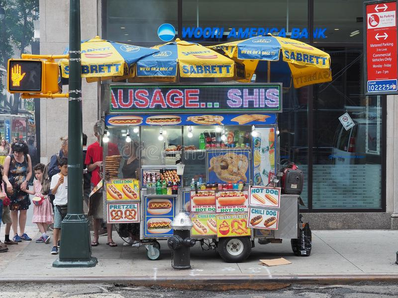 New York, USA. Street food. Fast food cart selling hot dogs and other snack or food in New York City. Food trucks along the town stock photos