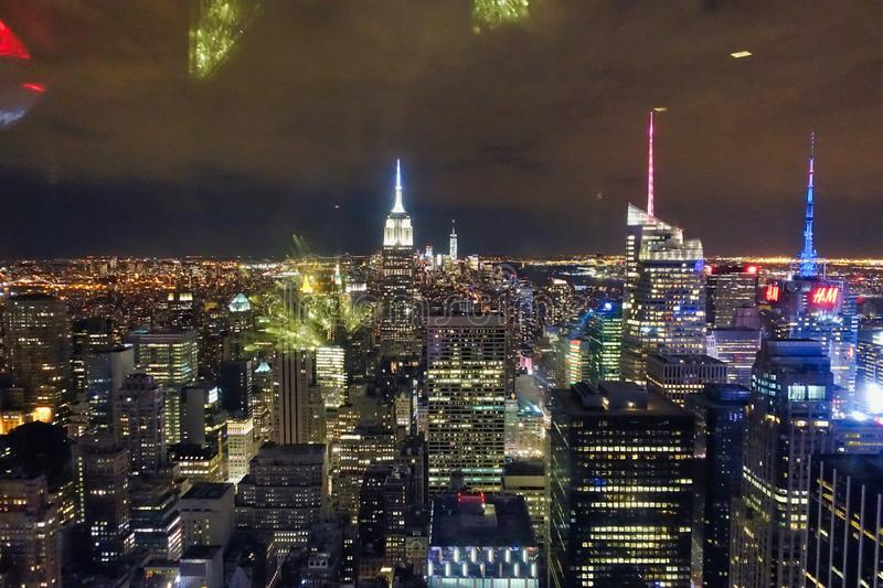 New York City Skyline at Night. View of New York city skyline at night with office buildings lights royalty free stock photography
