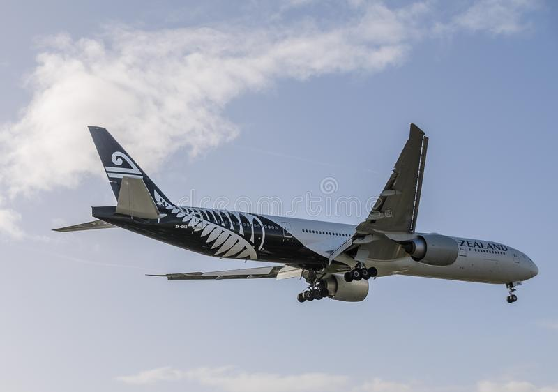 New Zealand airways jet landing at Heathrow. October 2017 landing Gear down stock photography