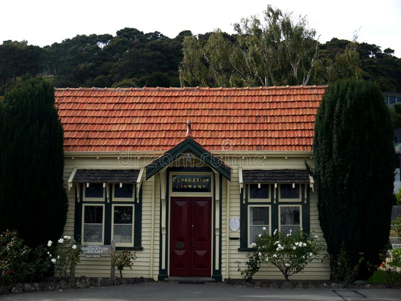 New Zealand: Akaroa historic 19th century library. Historic coronation 19th century library in Akaroa, South Island, New Zealand, with tile roof stock photography
