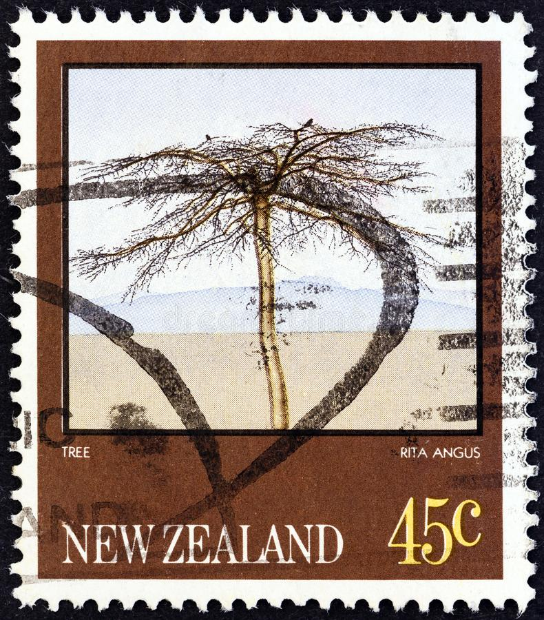 NEW ZEALAND - CIRCA 1983: A stamp printed in New Zealand from the `Paintings by Rita Angus` issue shows Tree, circa 1983. NEW ZEALAND - CIRCA 1983: A stamp stock photos