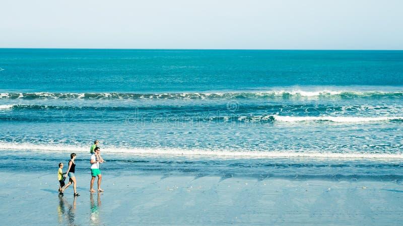 New Zealand family enjoys beach stock photo