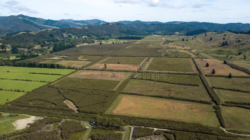 New Zealand Farmlands In Hutt Valley Aerial. Beautiful Upper Hutt farmlands in between mountains royalty free stock photos