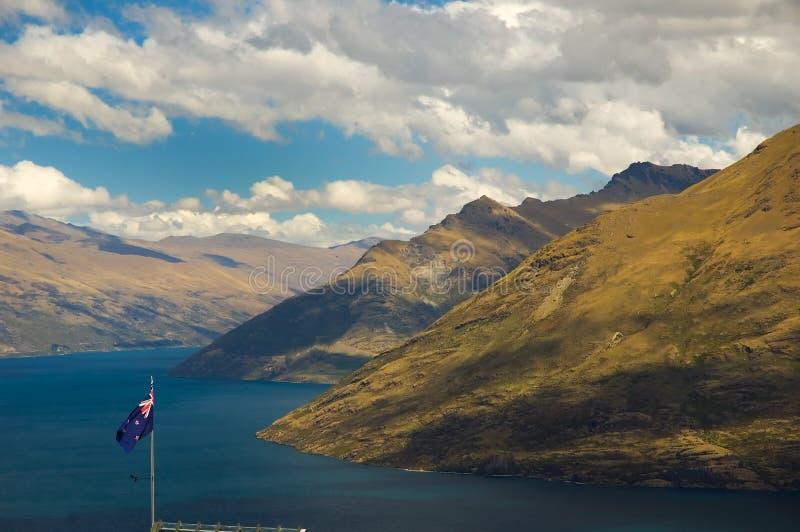 New Zealand flag with mountain stock photo