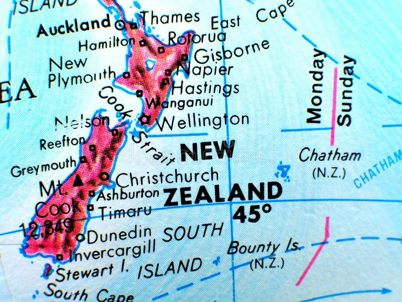 New Zealand focus macro shot on globe map for travel blogs, social media, website banners and backgrounds. stock image