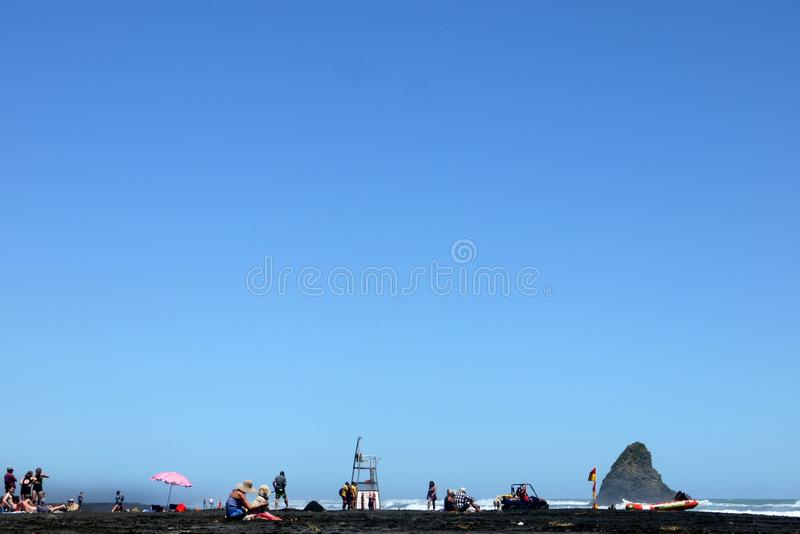 Download New Zealand: Holiday-makers On Black Sand Beach Editorial Stock Image - Image: 37652449
