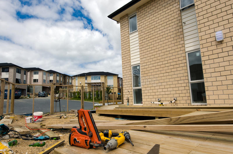 New Zealand Housing Property and Real Estate Market. AUCKLAND,NZ - JAN 11:Working tools in new homes building site on JAN 11 2014.House prices are booming around royalty free stock photos