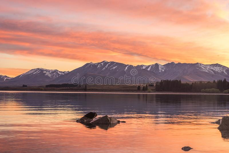 New Zealand landscape, snow mountain in autumn with colourful mo. Rning sunrise sky reflect on still lake stock photo