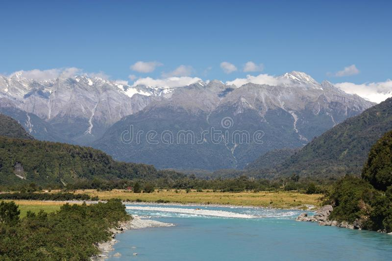 New Zealand landscape. Whataroa River and Southern Alps mountain range royalty free stock photography
