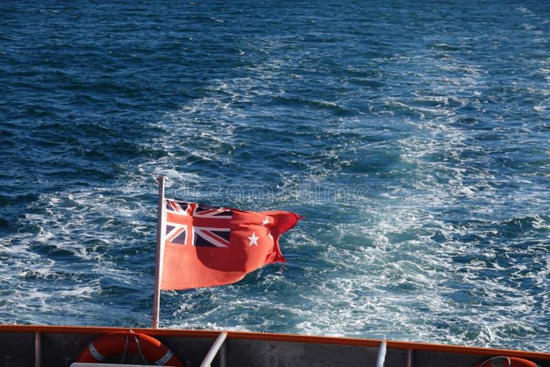 New Zealand Maritime Flag at Tasman sea stock photo