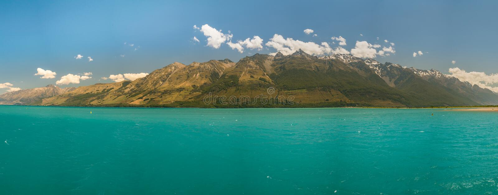 New Zealand mountain and blue lake against sky. Natural landscape background panorama view royalty free stock image