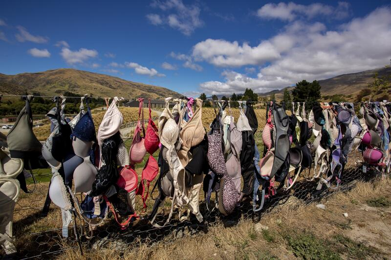 New Zealand. New Zealand breast cancer foundation. Central Otago,New Zealand - February 14,2020 : Cardrona Bra Fence gradually became a well known site as the stock images