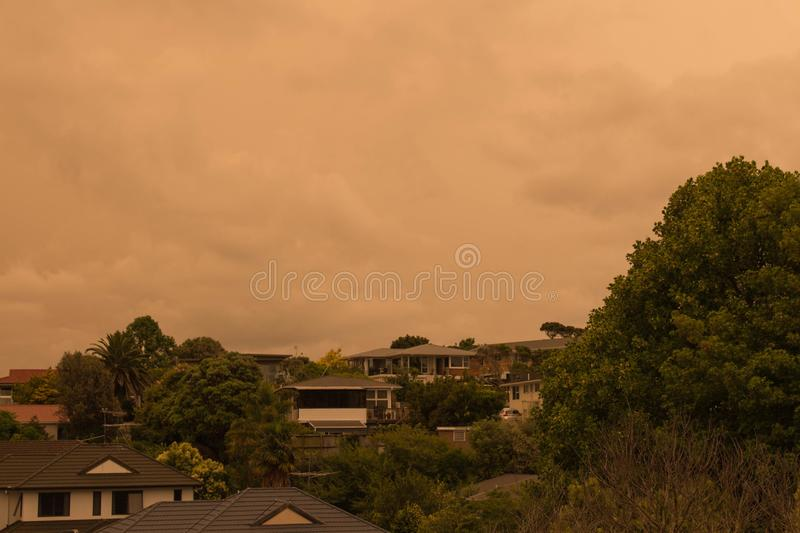 Haze from Australia`s bushfires hangs over North Shore in Auckland, New Zealand. New Zealand, North Island - January 5 2020: the view of haze in the sky  from royalty free stock image