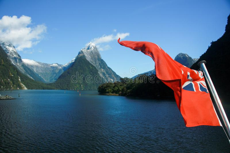 New Zealand Red Ensign maritime flag on a boat on Milford Sound stock photo