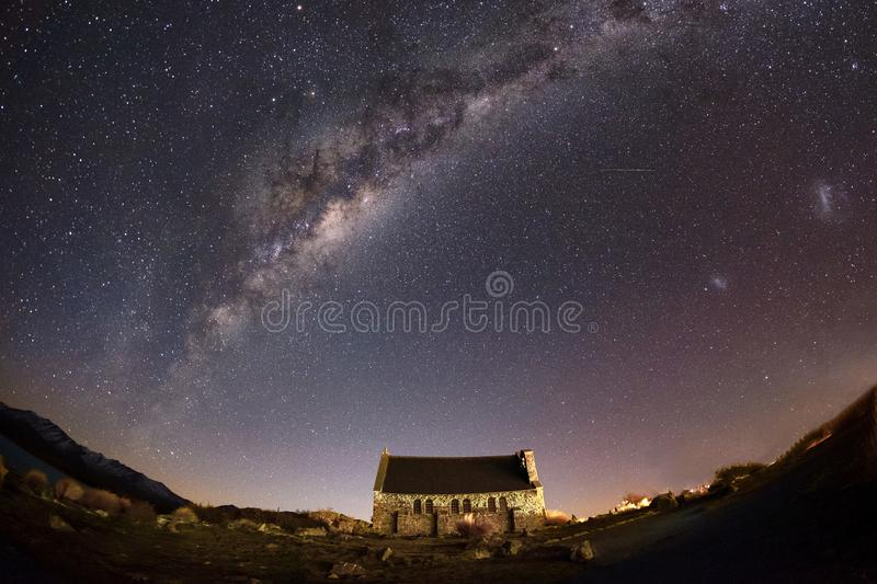 Travel landscape image of historic church with night sky at Lake Tekapo, New Zealand stock photography