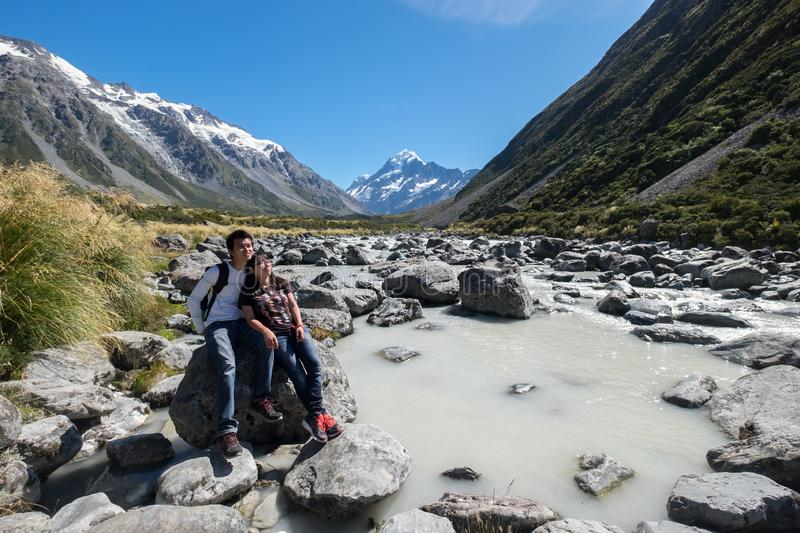 Loving couple explores Mount Cook, New Zealand royalty free stock photo