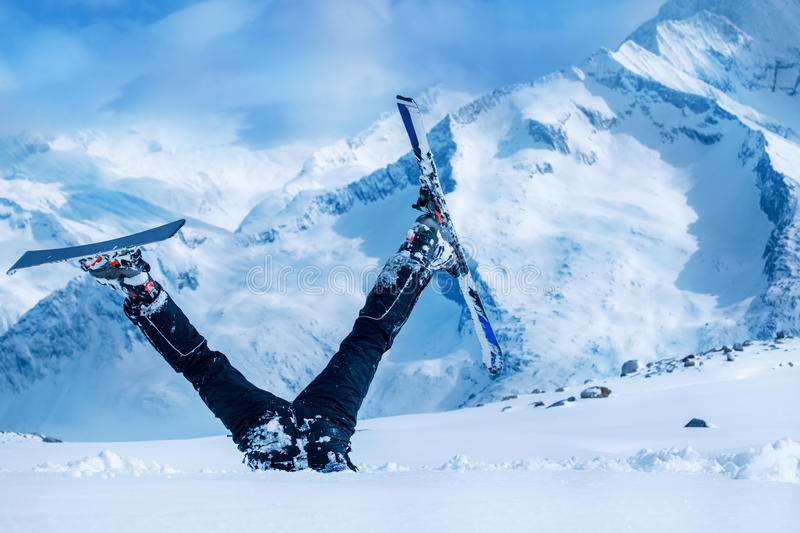 Newbie skier. Stuck in deep snow with his legs upside down stock images