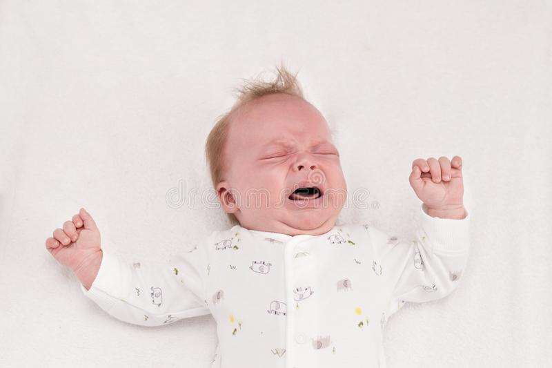 Newborm baby screaming just after born. Infant boy crying royalty free stock photos