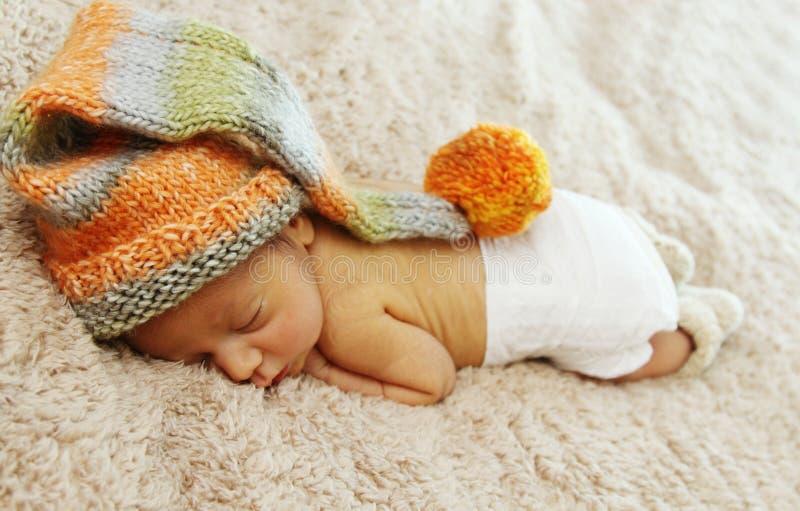 Newborn спать младенец стоковые изображения